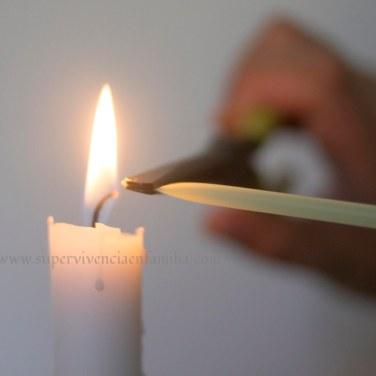 Monodosis de Betadine sellando la pajita con la vela